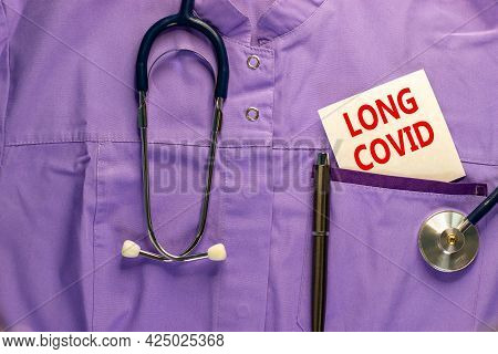 Covid-19 Pandemic Long Covid Symbol. Medical Uniform, White Card With Words Long Covid, Metalic Pen