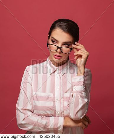 Clever Woman In Glasses On Red Background Portrait