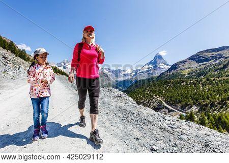 Hiking - Hiker Woman On Trek With Backpack Living Healthy Active Lifestyle. Hiker Girl Walking On Hi