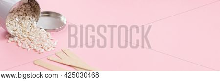 Banner With Beautician Set Of Depilation On Pink Background. Hair Removal Wax Beads In Metal Jar And