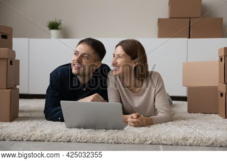 Happy Couple Renters Use Laptop In New Home