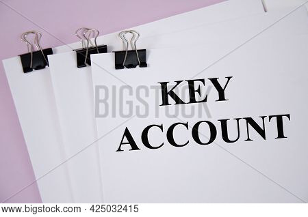 Key Account The Text Is Written On White Piece Of Paper And Pink Background