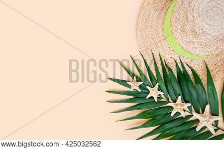 Straw Hat, Palm Leaf And Sea Stars On Neutral Beige Background. Summer Travel And Vacations Concept.