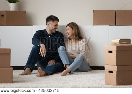 Smiling Couple Renters Relax On Moving Day