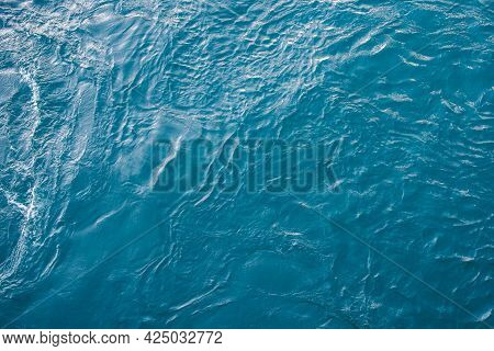 Blue Sea Surface With Waves And Ripples. Top View