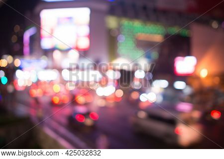 Blurred Street Lights, Urban Abstract Background. Defocused Image Of Night City. Vehicles On The Roa