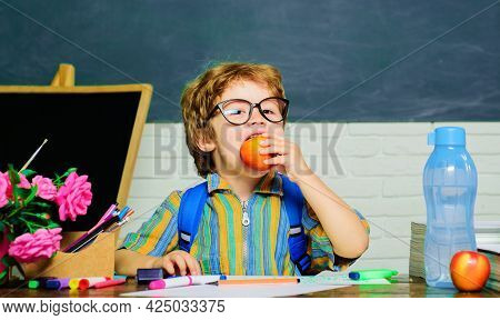 Schoolboy Eating Apple. Healthy School Breakfast For Child. Fruit Snack. Lunch Time.