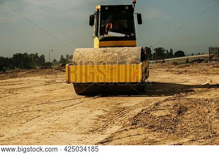 Yellow Heavy Vibratory Roller On Asphalt Works. Road Repair. Highway Repair On A Sunny Summer Day. H