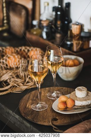Trendy Orange Or Amber Wine, Apricots And Cheese