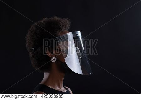 African American Woman Profile In Black Medical Face Mask And Transparent Protective Face Shield. Sa