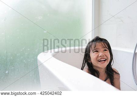 Happy Girl Taking A Bath Together On A Bathtub