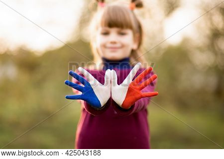Freedom France Concept. Cute Child Forming Flying Bird Gesture With Painted In France Colors Hands A
