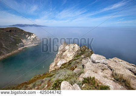 Potato Harbor On Santa Cruz Island With Mist Coming In Under Blue Cirrus Sky In The Channel Islands