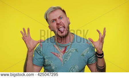 Little Bit Crazy. Portrait Of Bearded Adult Guy 30 Years Old In Fashion T-shirt Demonstrating Tongue