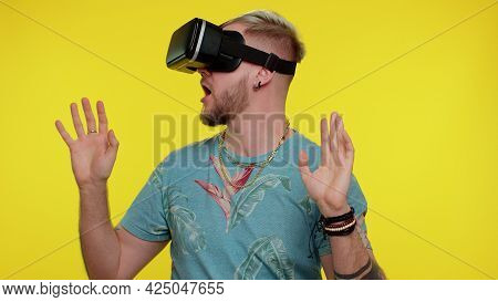 Amazed Tourist Adult Man Using Headset Helmet App To Play Simulation Game. Watching Virtual Reality