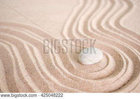 Japanese Zen Garden Stone On Wave Sand Beach. Rock Or Pebbles With Copy Space. For Aroma Therapy Spa