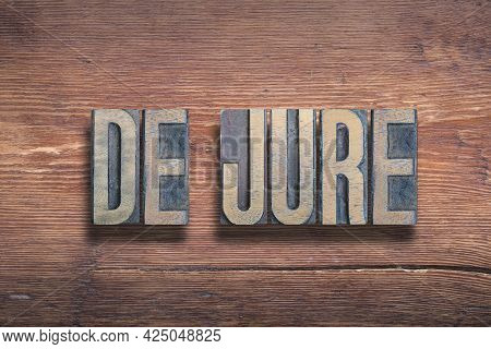 De Jure Ancient Latin Saying Meaning «something Established By Law» Combined On Vintage Varnished Wo