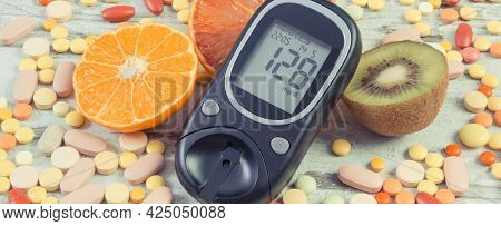 Glucometer With Result Of Sugar Level, Fresh Natural Fruits And Medical Pills. Diabetes And Healthy