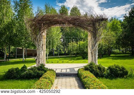 Solemn Arch In The Garden. Place For Luxury Wedding Arch Outdoors.