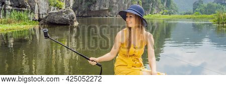 Banner, Long Format Woman Tourist In Boat On The Lake Tam Coc, Ninh Binh, Viet Nam. Its Is Unesco Wo