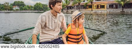 Banner, Long Format Dad And Son Tourists In Boat On The Lake Tam Coc, Ninh Binh, Viet Nam. Its Is Un