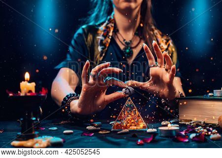 Astrology And Horoscope. A Witch Holds A Stone With The Sign Of The Zodiac Libra. Close Up. The Conc