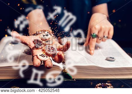 Astrology And Horoscope. Fortune Teller's Hand Holds The Sparkling Zodiac Stones In The Palm Of Her