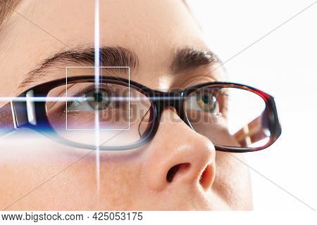 Healthy Vision And Laser Eye Surgery. Close Up Of Woman's Eyes In Glasses With Laser Light. Isolated
