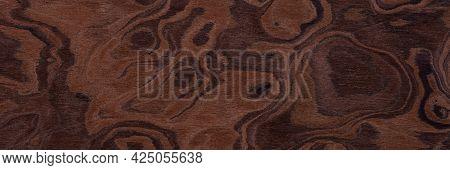 Contrast Brown Nut Veneer Background For Your Elegant Design. Long Plank Texture. Wooden Pattern.