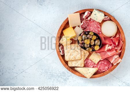 Cold Meat And Cheese Board, Shot From Above With Copy Space. Prosciutto Di Parma Ham, Blue Cheese, O