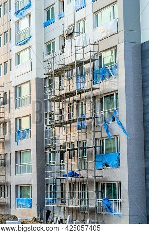 Daejeon; South Korea; June 20, 2021: Scaffolding Beside Exterior Wall Of New Highrise Building At Co