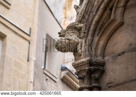 Stone Gargoyle On The Wall Of Ancient Cathedral