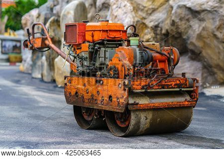 Asphalt Paver Machine During Road Work, Road Machinery At Construction Site For Paving Works, Screed