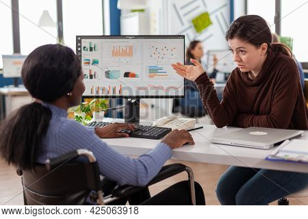 Businesswomen Planning Financial Strategy Looking On Computer Working Together In Start Up Company O