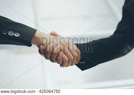 Businessmans Handshake. Successful Businessmen Handshaking After Good Deal. Business Partnership Mee