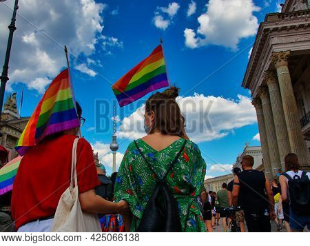 Berlin, Germany - June 26, 2021 - Two Lesbian Women Hold A Rainbow Flag In The Air At The Christophe