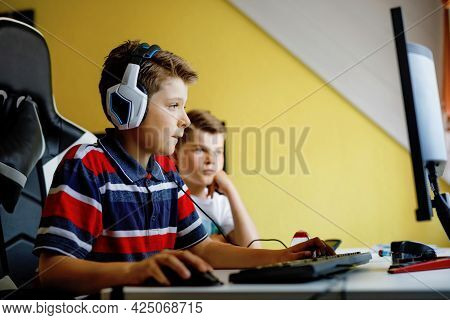 Two Kids Boys Playing Computer Games On Desktop Pc. Modern Addict Activity For Children. Siblings An