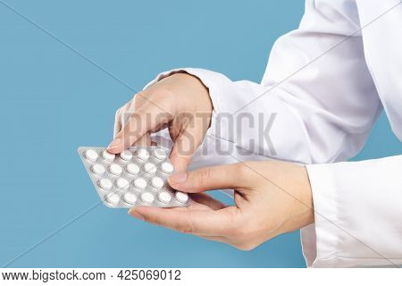 Female Doctor Pointing At Pills. Medicine And Pharmacy