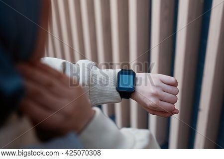 Close Up Of Modern Young Woman Checking Smartwatch During Morning Run, Copy Space