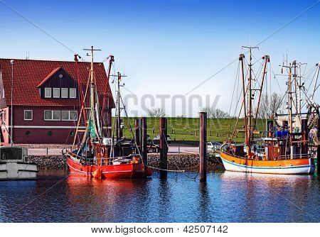 Two shrimp fishing boats in the harbor, quietly scene in the evening sun