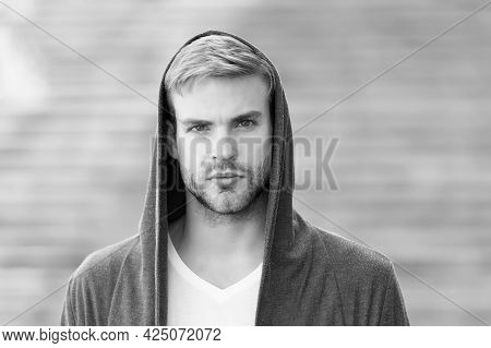 Popular Street Style. Handsome Man With Hood Standing Urban Background. Fashion Trend. Comfortable C