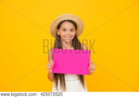 Cheerful Fashion Model. Little Girl Hold Paper Sheet. Beach Fashion For Kids. Small Child On Yellow