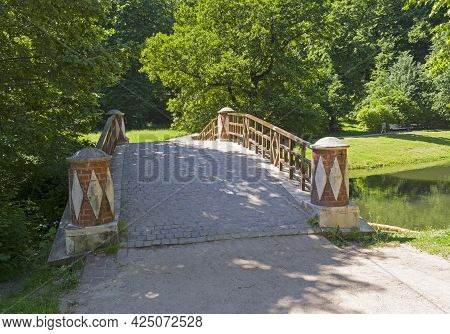 Moscow, Russia - June 20, 2021: A Small Beautiful Footbridge Over The Ravine. Tsaritsynsky Park, Mos