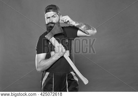 Follow His Style. Bring More Style For Bearded Face. Man Worker Hold Axe. Cut His Beard. Lumberjack