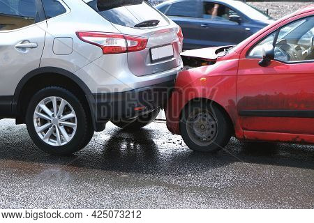 An Accident On The Street, Cars Are Damaged After A Collision In The City