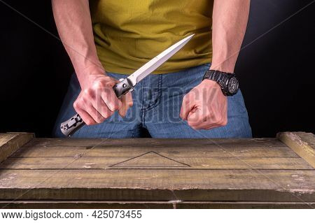 Hold A Large Knife In Your Hand. Two Hands In The Frame. The Man Attacks With A Knife. Knife Attack.