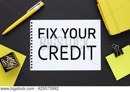 Fix Your Credit. Text On A Black Background, On White Paper, Next To Bright Stickers And A Yellow Pe