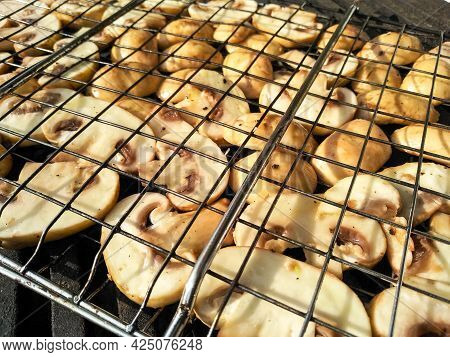 Grilled Mushrooms Roasting On Bbq Grill Outdoor. Grilled Food Fried In Charcoal Grills. Tasty Delici