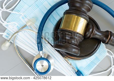 Law Gavel, Stethoscope And Face Anti Virus Masks Close Up, Medical Law Concept