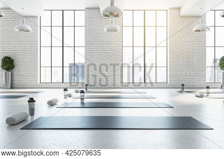 Stylish Bright White Yoga Studio Gym Interior With Brick Wall, Window And City View. 3d Rendering